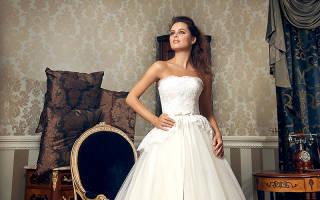 Свадебное платье с басками, карманами, воланами, трапеция